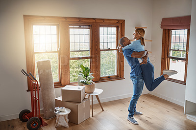 Buy stock photo Shot of a loving young couple celebrating their new home