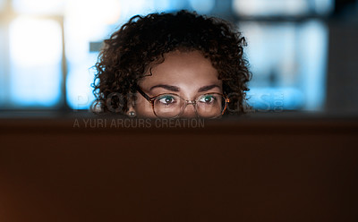Buy stock photo Shot of a young businesswoman working late on a computer in an office