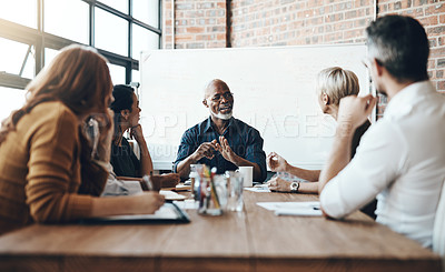 Buy stock photo Cropped shot of a mature businessman leading a meeting in the boardroom
