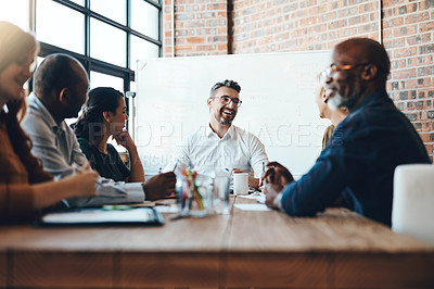 Buy stock photo Shot of a businessman leading a meeting in the boardroom