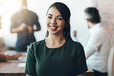 Buy stock photo Cropped portrait of a young businesswoman sitting in the boardroom during a presentation