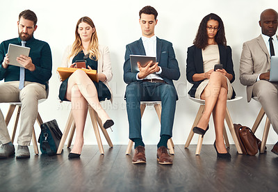 Buy stock photo Full length shot of a group of businesspeople sitting in a waiting room before their interviews