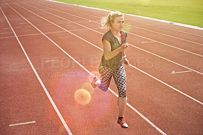 Buy stock photo High angle shot of an athletic young woman running on the track