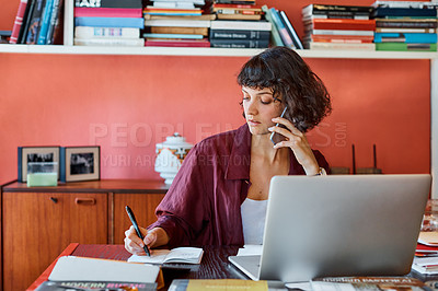 Buy stock photo Cropped shot of a creative worker talking on her cellphone in a modern office