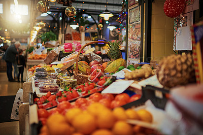 Buy stock photo Shot of a bunch of market stalls placed next to each other selling fruit at a market during the day