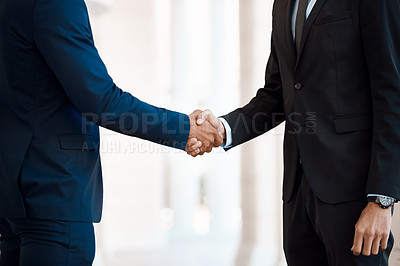 Buy stock photo Cropped shot of unrecognizable businessmen shaking hands outside