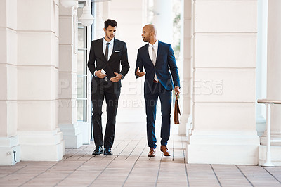 Buy stock photo Shot of young handsome businessmen talking outside