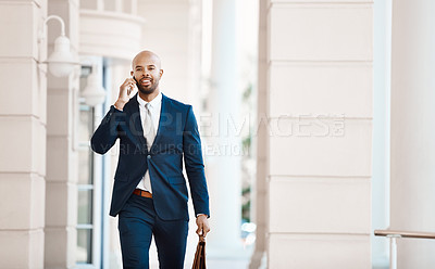 Buy stock photo Cropped shot of a young handsome businessman on a call outside