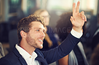 Buy stock photo Cropped shot of a handsome young businessman asking a question during a seminar