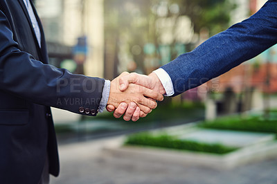 Buy stock photo Cropped shot of unrecongizable businessmen shaking hands outside