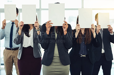 Buy stock photo Shot of a group of businesspeople holding blank pages in front of their faces in a modern office