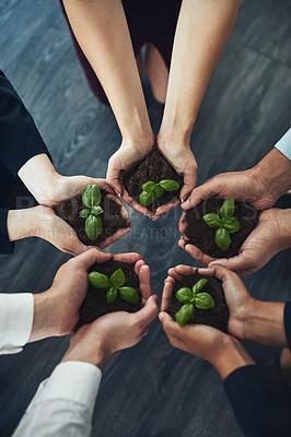 Buy stock photo Cropped shot of a group of businesspeople holding plants growing out of soil