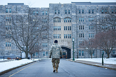 Buy stock photo Rearview shot of a young soldier walking to the entrance of an academy