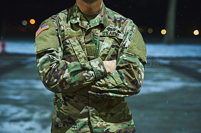 Buy stock photo Cropped shot of a soldier standing outside on a cold night at a military academy