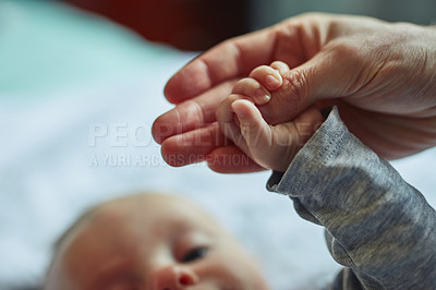 Buy stock photo Closeup shot of a mother holding her baby's hand