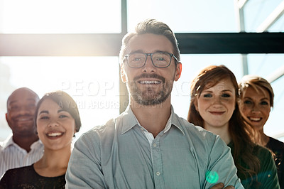 Buy stock photo Cropped shot of a businessman posing with his arms crossed with his colleagues in the background