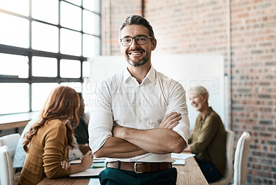 Buy stock photo Portrait of a confident businessman standing in the boardroom during a meeting