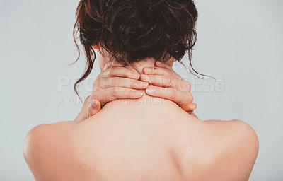 Buy stock photo Rearview studio shot of an attractive woman posing against a gray background