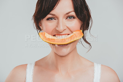 Buy stock photo Studio shot of a beautiful woman holding a slice of sweet melon