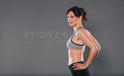 Buy stock photo Studio portrait of a sporty young woman posing against a grey background