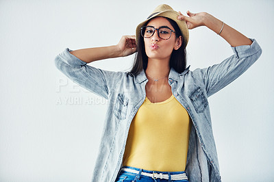 Buy stock photo Studio shot of a beautiful young woman wearing a hat against a white background