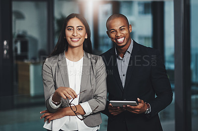 Buy stock photo Portrait of two young businesspeople standing together in an office