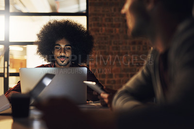 Buy stock photo Cropped shot of a handsome young male designer sitting in the boardroom during a meeting