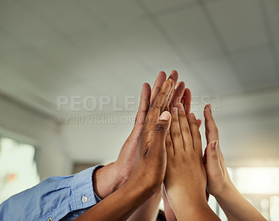 Buy stock photo Cropped shot of a group of businesspeople joining their hands in solidarity