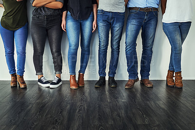 Buy stock photo Cropped shot of a group of unrecognizable people wearing jeans while standing in a row