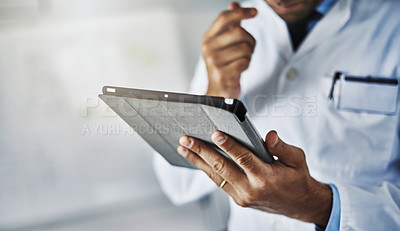 Buy stock photo Closeup shot of an unrecognizable doctor working on a digital tablet