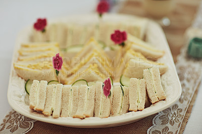 Buy stock photo Shot of triangular sandwiches on a table at a tea party inside