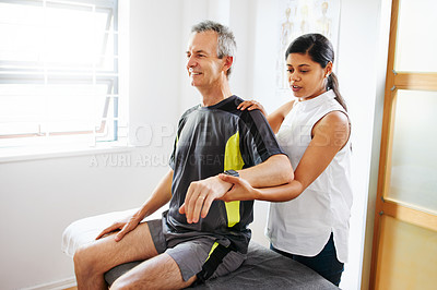 Buy stock photo Shot of a mature man having a physio session