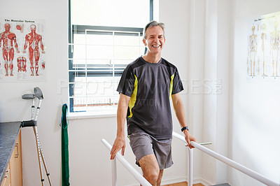 Buy stock photo Shot of an elderly man having a physio session