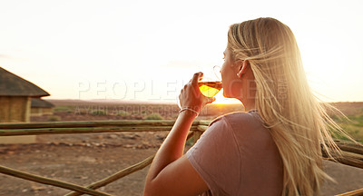Buy stock photo Cropped shot of a beautiful young woman drinking beer at a resort in nature