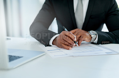 Buy stock photo Closeup shot of an unrecognizable businessman filling in paperwork in an office