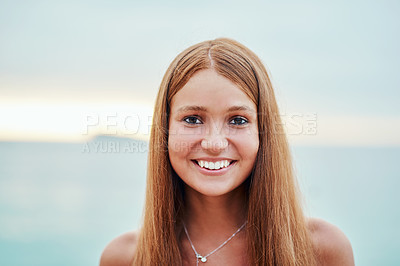 Buy stock photo Cropped portrait of an attractive young woman on the beach