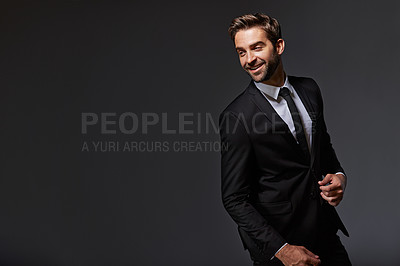 Buy stock photo Cropped shot of a handsome young businessman standing against a grey background
