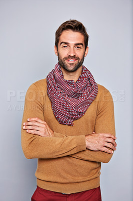 Buy stock photo Studio portrait of a handsome young man standing with his arms crossed against a grey background