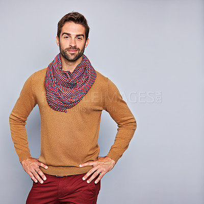 Buy stock photo Studio portrait of a handsome young man standing with his hands on his hips against a grey background
