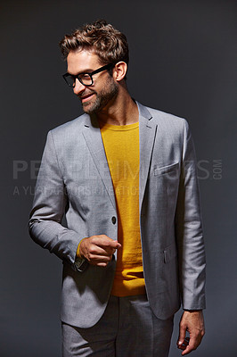 Buy stock photo Studio shot of a handsome young businessman standing against a grey background