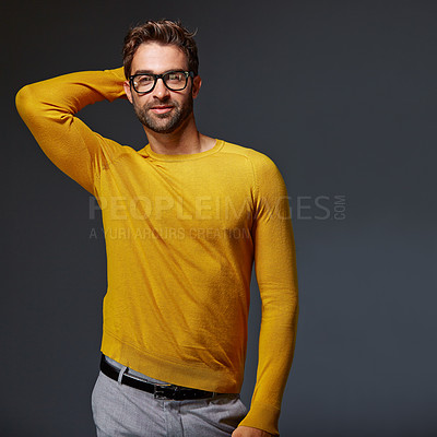 Buy stock photo Studio portrait of a handsome man posing against a grey background