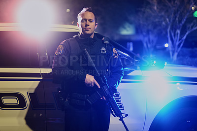Buy stock photo Cropped portrait of a handsome young policeman standing with his assault rifle while out on patrol
