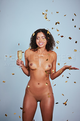Buy stock photo Studio shot of a sexy young woman posing nude against a blue background
