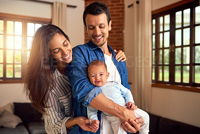 Buy stock photo Cropped shot of an affectionate young couple and their baby boy at home