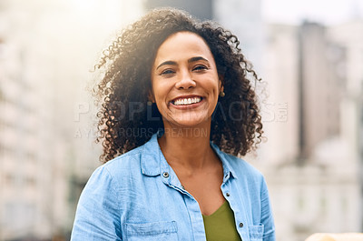 Buy stock photo Shot of an attractive young woman out and about in the city