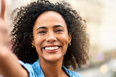 Buy stock photo Shot of a young woman out and about in the city