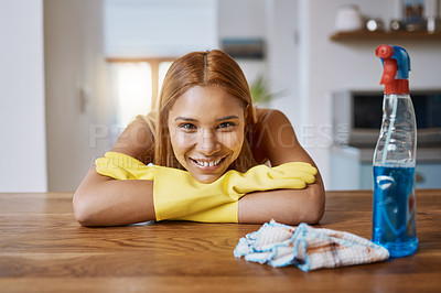 Buy stock photo Shot of a young woman cleaning up the kitchen at home