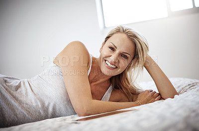 Buy stock photo Shot of a mature woman lying in bed