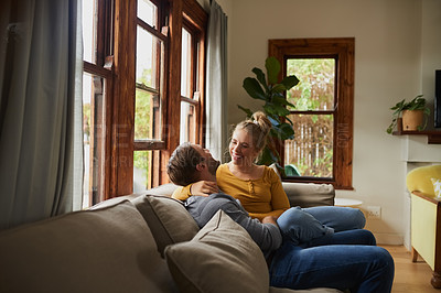Buy stock photo Cropped shot of a young couple being affectionate in the living room at home
