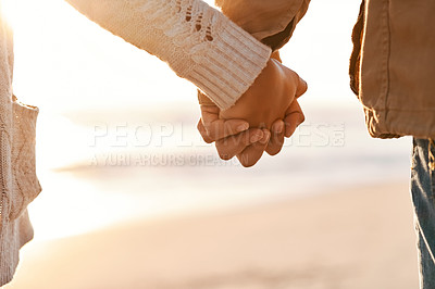 Buy stock photo Cropped shot of an unrecognizable couple holding hands on the beach